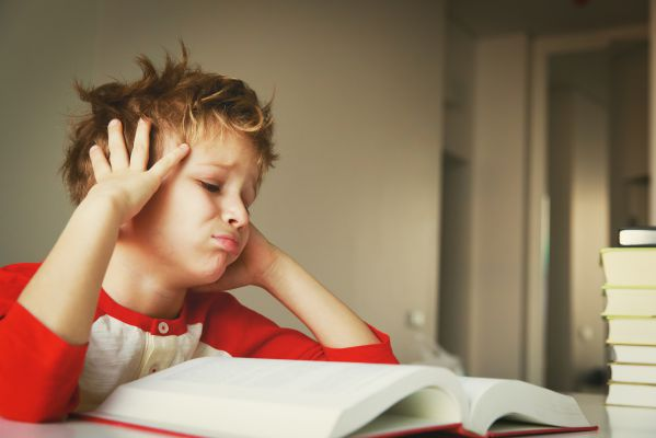 A Child Experiencing Headache While Reading